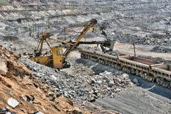 Loading of iron ore on the train Stock Photo