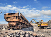 Loading of iron ore. On the train in career royalty free stock images