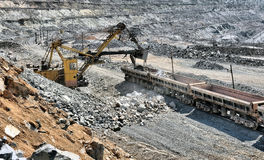 Loading of iron ore on the train Royalty Free Stock Photography