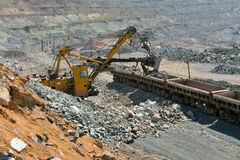 Loading of iron ore on the train Stock Images