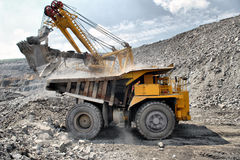 Loading of iron ore on truck Royalty Free Stock Photography