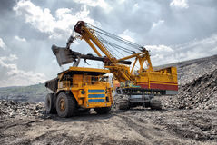 Loading of iron ore stock images