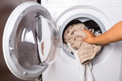 Loading laundry to the washing machine Royalty Free Stock Images
