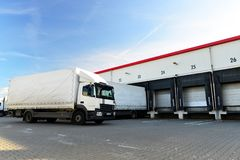 Loading of lorries at the warehouse of a freight forwarding company. Closeup royalty free stock image