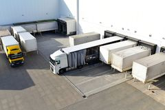 Loading of lorries at the warehouse of a freight forwarding company. Closeup stock images
