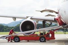 Loading luggage to airplane Stock Photos