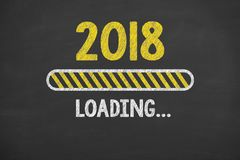 Loading New Year 2018 on Blackboard Background. New year working Stock Photo