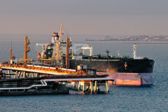 Loading oil supertanker Stock Images