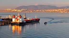 Loading oil tanker. Loading of oil in a tanker in oil terminal Stock Photos