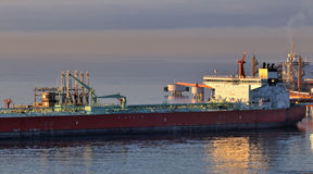 Loading oil tanker. Loading of oil in a tanker in oil terminal Stock Image