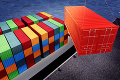 Loading orange container on freight ship in port Royalty Free Stock Photos