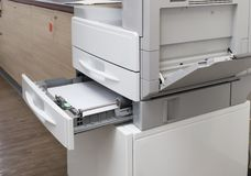 Loading paper tray of the photocopier at the office with full access control for key card. Loading paper tray of the photocopier machine at the office with a royalty free stock photography
