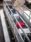 Loading passenger cargo at the airport stock photos