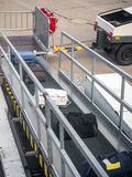 Loading passenger cargo at the airport stock photo