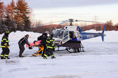 Loading patient into Lifenet helicopter Stock Photography