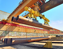 Loading pipes With Bridge Crane Stock Photography