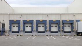 Cargo Doors. Loading Ramp Cargo Doors at Distribution Center Warehouse royalty free stock photos