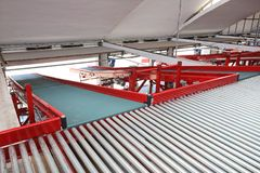 Conveyor Rollers Sorting. Loading Ramp With Conveyor Belt in Distribution Warehouse stock images
