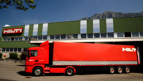Loading a red  truck. Expedition Hilti products in stock Lichtenteinskom near Vaduz Royalty Free Stock Image