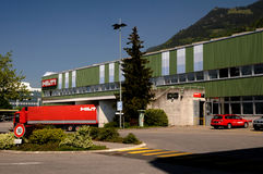 Loading a red  truck. Expedition Hilti products in stock Lichtenteinskom near Vaduz Stock Image