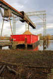 Loading a River Barge with Wood Chips Stock Photography