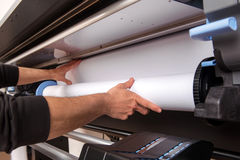 Loading roll of paper on printer Royalty Free Stock Image