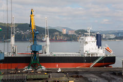 Loading of rolled metal at the port of Nakhodka, Russia. Royalty Free Stock Photography