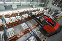 Loading sacks with forklift loader stock photo