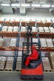 Loading sacks with forklift loader in warehouse