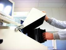 Loading of the sample. Into the measuring station Stock Photos