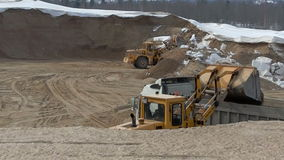 Loading sand in huge sandpit. View of loaders. Loading sand in huge sandpit. View of working loaders stock footage