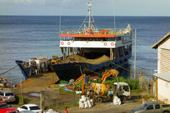 Loading sand on an inter-island barge in the caribbean Royalty Free Stock Images