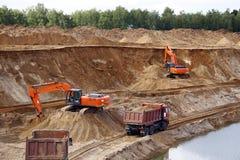 Loading sand into trucks on the sandy career stock image