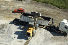 Loading. A Construction vehicle loading sand onto a cargo truck viewed from above royalty free stock photography