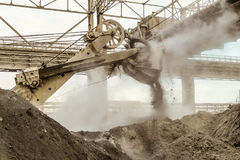 Loading of slag with a heavy bucket excavator. Heavy industry. Loading of slag with a heavy bucket excavator in the metallurgical industry Stock Images