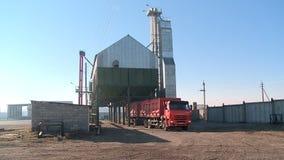 Loading grain into storage stock video footage