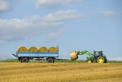 Loading straw rolls Royalty Free Stock Photo