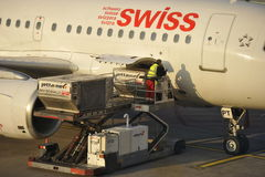 Loading a Swiss Plane Royalty Free Stock Photos