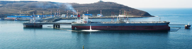 Loading  tanker by oil. Loading of the sea tanker by petroleum crude on a bulk-oil mooring Royalty Free Stock Photos