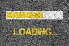 Loading. Text on the asphalt Stock Photography
