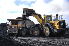 Loading the truck. Truck loaded up with coal at an open cast Coal Mine, Westland, New Zealand Royalty Free Stock Image
