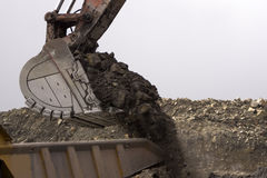 Loading the truck. 190 ton digger loading a 70 ton tiptruck at an open cast coal mine, Westland, New Zealand Stock Photo