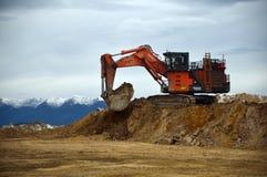 Loading the truck. 190 ton digger loading a 70 ton tiptruck at stockton coal mine, Westland, New Zealand Stock Photos