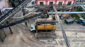 Loading a truck Transporter at an industrial enterprise top view from a drone stock image