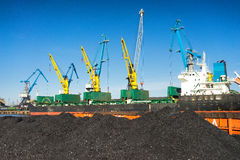 Loading and unloading of coal at the port Stock Photo