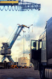 Loading and unloading at the port with cranes in Europe Stock Photo