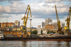 Loading and unloading of sand by crane. The shore of the river Moscow Stock Image