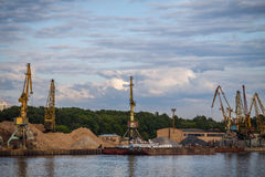Loading and unloading of sand by crane. The shore of the river Moscow Royalty Free Stock Images