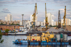 Loading and unloading of sand by crane. The shore of the river Moscow Stock Photos
