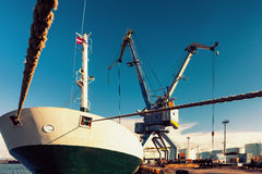 Loading and unloading of the ship in the port with cranes in Eur Stock Photography